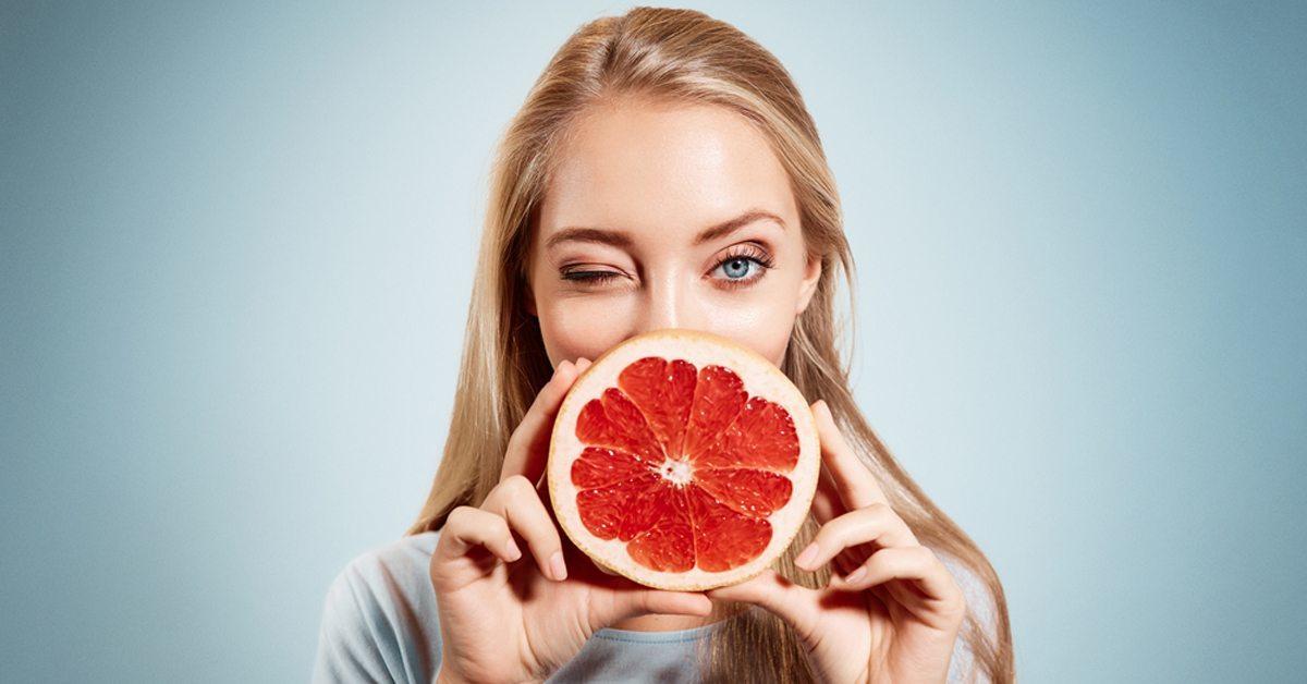blonde-with-grapefruit-winking-facebook